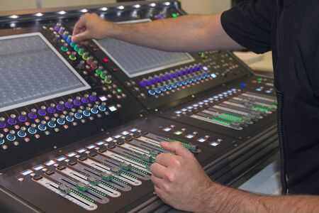 Photo for Man using mixing console in sound recording studio. Music - Royalty Free Image