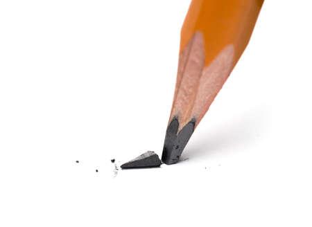 Photo pour Broken head of sharp pencil on a white paper - image libre de droit