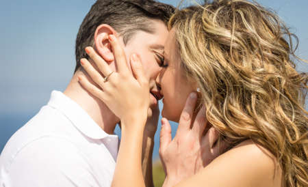 Photo for Passionate beautiful love couple kissing outdoors in a summer day over nature background - Royalty Free Image