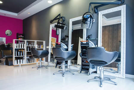 Photo for Interior of empty modern hair and beauty salon decorated in gray and fuchsia colors - Royalty Free Image