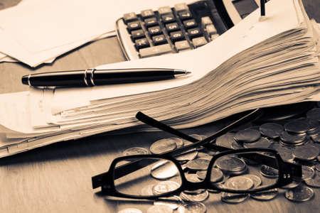 Photo pour Receipts in paper nail on accountant desk - image libre de droit