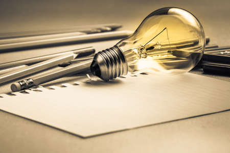 Photo for Creative writing, light bulb and many pencils on the table - Royalty Free Image