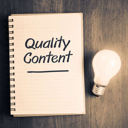 Photo for Quality Content topic on notebook with glowing light bulb - Royalty Free Image