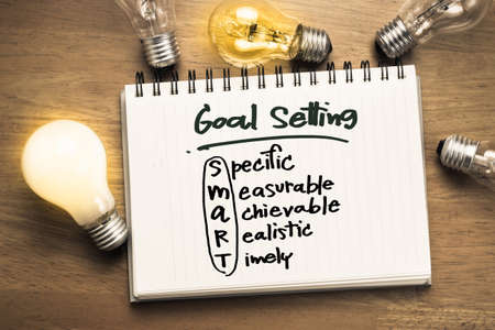 Photo pour Goal setting as memo on notebook with many light bulbs - image libre de droit