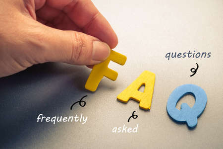 Photo for Hand arrange wood letters as FAQ abbreviation ( frequently asked questions ) - Royalty Free Image