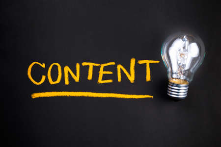 Photo for Content topic with glowing light bulb - Royalty Free Image