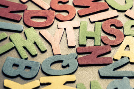 Photo for Closeup MYTHS word in scattered wood letters - Royalty Free Image