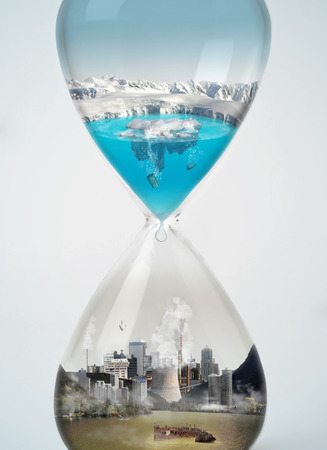 Foto de Pollution, save earth, eco concept in hourglass  - Imagen libre de derechos