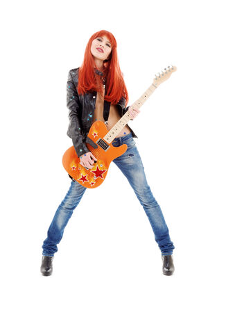 Photo for picture of lovely redhead girl with orange guitar - Royalty Free Image
