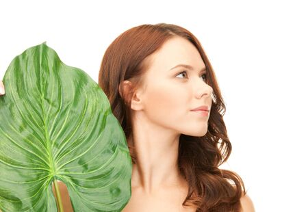 picture of woman with green leaf over white