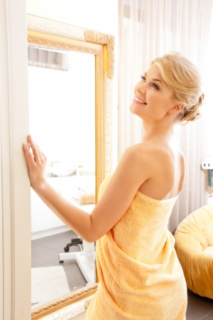 picture of beautiful woman in spa salon with mirror