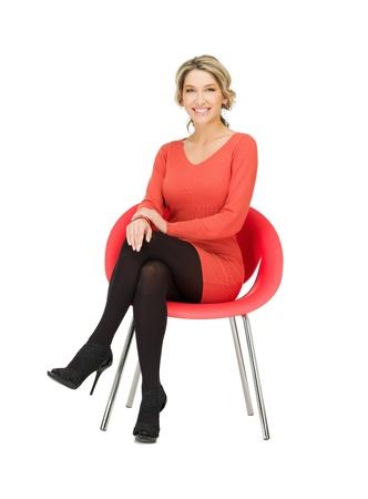 Photo pour picture of young businesswoman sitting in chair   - image libre de droit