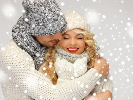 Photo pour bright picture of family couple in a winter clothes - image libre de droit
