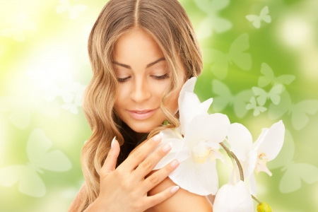 picture of beautiful woman with orchid flower and butterflies