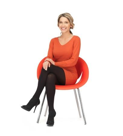 Photo pour nice woman in dress sitting in chair - image libre de droit