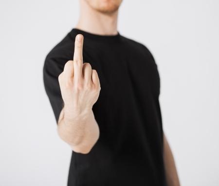 Photo pour close up of man showing middle finger - image libre de droit