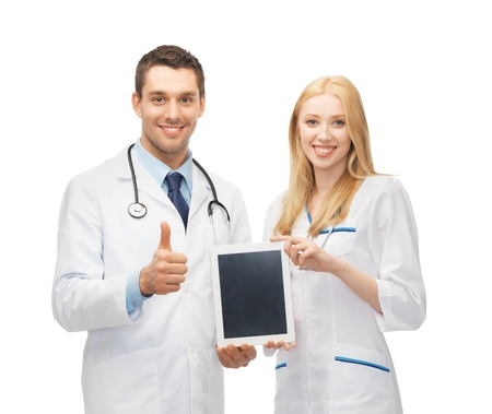 Foto de two young doctors holding tablet pc in hands - Imagen libre de derechos