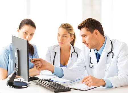 Photo for picture of young team or group of doctors working - Royalty Free Image