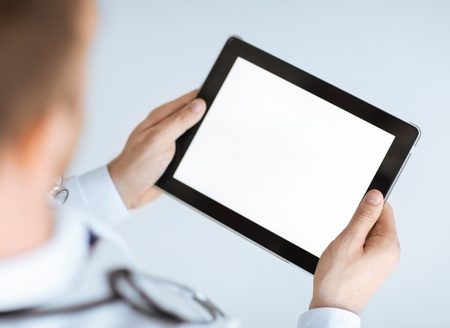 Photo for close up of male doctor hands holding tablet pc - Royalty Free Image