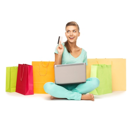 Photo pour woman with laptop, shopping bags and credit card - image libre de droit