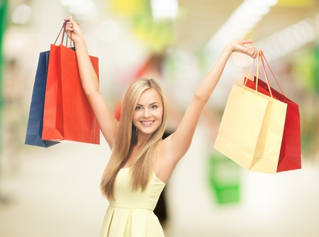 Photo pour happy woman with shopping bags at the mall - image libre de droit