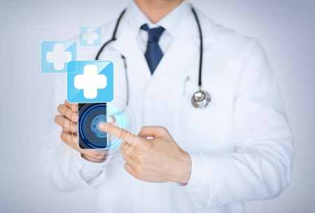 Foto de close up of male doctor holding smartphone with medical app - Imagen libre de derechos