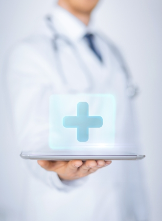 Photo for close up of male doctor holding tablet pc with medical app - Royalty Free Image
