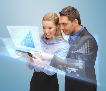 Foto de picture of two business people working with virtual screen - Imagen libre de derechos