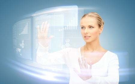 Photo pour picture of attractive businesswoman touching virtual screen - image libre de droit