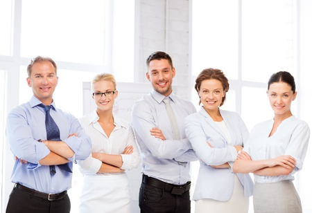 Photo for picture of happy business team in office - Royalty Free Image