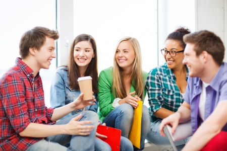 Photo for education concept - students communicating and laughing at school - Royalty Free Image