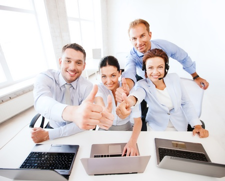 Photo pour business concept - group of office workers showing thumbs up in call center - image libre de droit