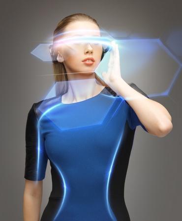 Photo pour beautiful woman in futuristic glasses and blue dress - image libre de droit