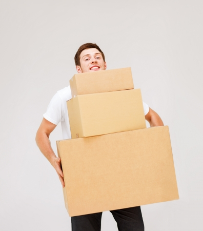 Photo for picture of young man carrying carton boxes - Royalty Free Image