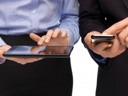 Foto per woman and man hands with smartphone and tablet pc - Immagine Royalty Free