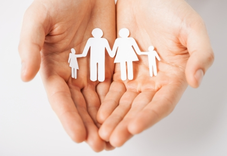 Photo for man hands showing family of paper men - Royalty Free Image