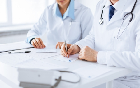 Foto de picture of doctor and nurse writing prescription paper - Imagen libre de derechos