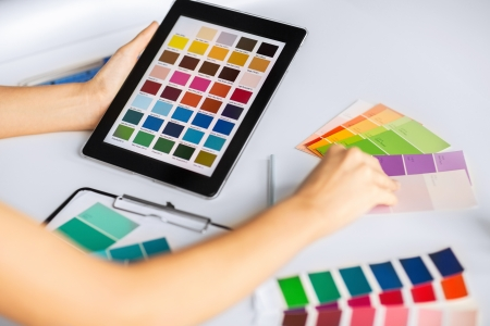 Photo pour interior design, renovation and technology concept - woman working with color samples for selection - image libre de droit