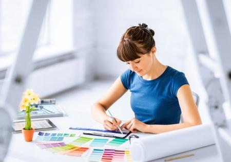 Foto de interior design and renovation concept - woman working with color samples for selection - Imagen libre de derechos