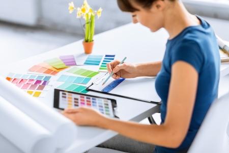 Foto de interior design, renovation and technology concept - woman working with color samples for selection - Imagen libre de derechos