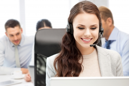 Photo pour business, technology and call center concept - helpline operator with headphones in call centre - image libre de droit
