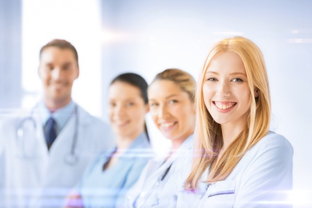 Photo for healthcare and medicine concept - female doctor in front of medical group - Royalty Free Image