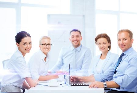 Foto de business and office concept - business team having meeting in office - Imagen libre de derechos