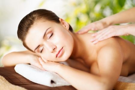 Photo pour beauty and spa concept - woman in spa salon getting massage - image libre de droit