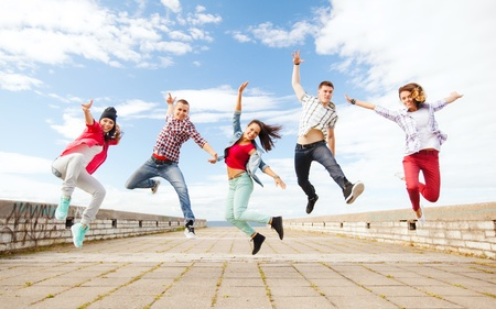 Photo for summer, sport, dancing and teenage lifestyle concept - group of teenagers jumping - Royalty Free Image