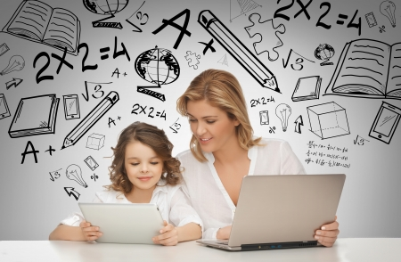 Foto de education, technology, internet and parenting concept - girl and mother with tablet and laptop - Imagen libre de derechos