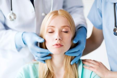 Photo pour healthcare, medical and plastic surgery concept - plastic surgeon or doctor with patient - image libre de droit