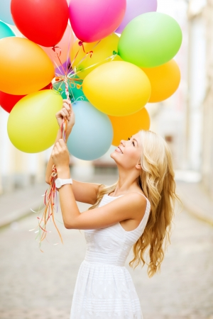 Photo for summer holidays, celebration and lifestyle concept - beautiful woman with colorful balloons in the city - Royalty Free Image