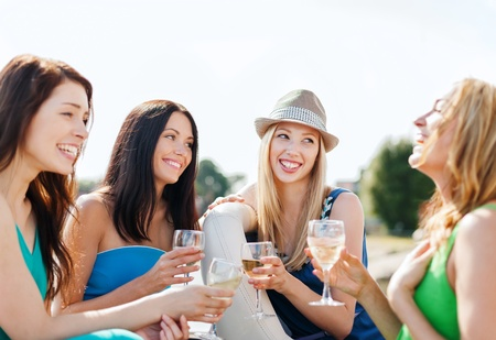Photo for summer holidays and vacation - girls with champagne glasses on boat or yacht - Royalty Free Image
