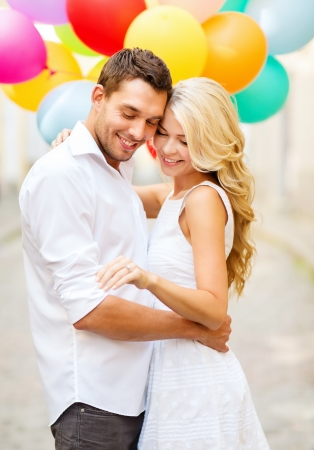 Photo for summer holidays, celebration and wedding concept - couple with colorful balloons and engagement ring - Royalty Free Image